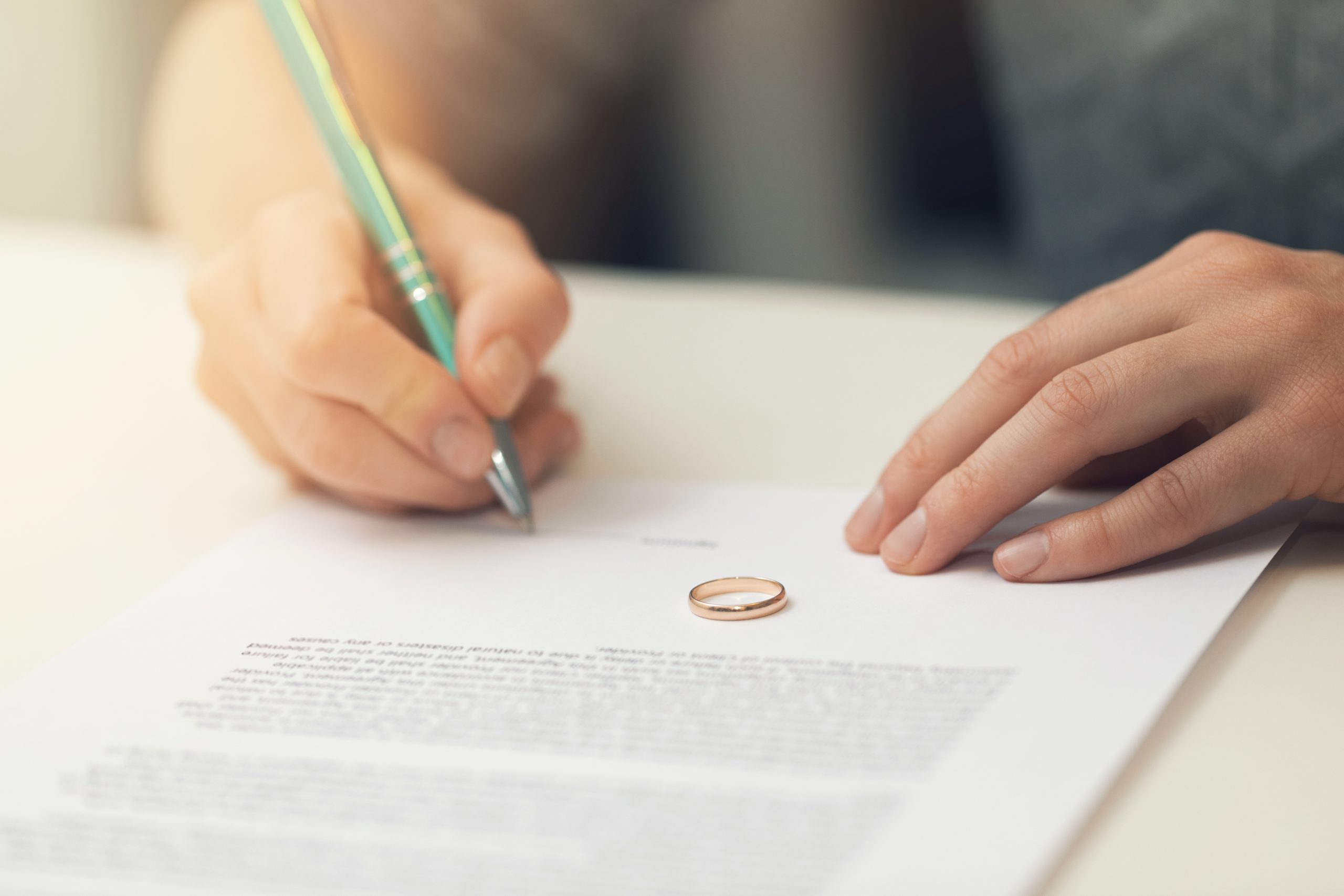 Divorce, Dissolution and Marriage Bill illustrated by signing papers