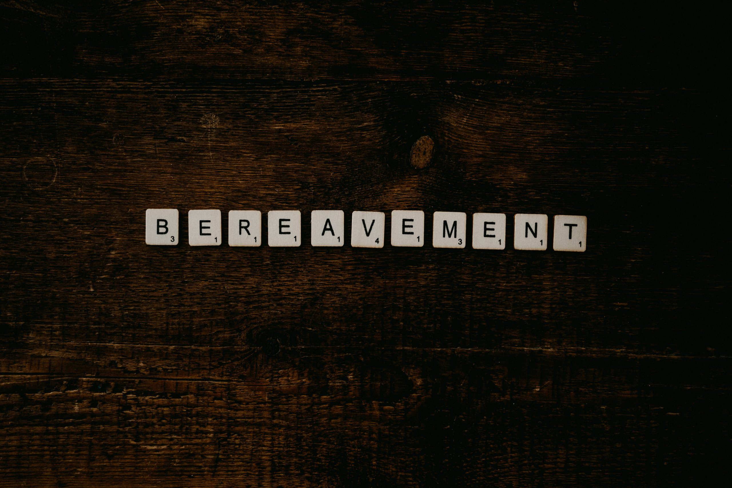 bereavement spelled out in letter tiles